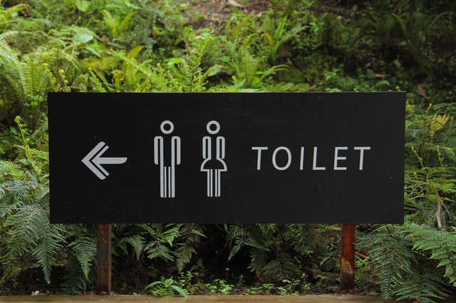 sign pointing to restrooms